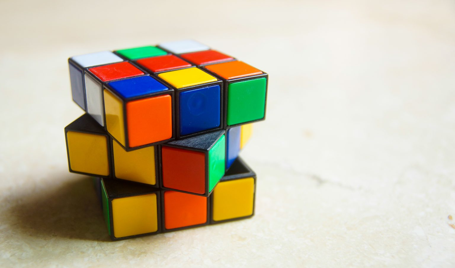 Rubik,Cube,Stand,Isolated,With,Unsolving,Shape.